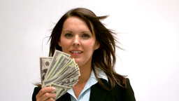 Woman fanning herself with money Stock Video Footage