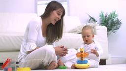 Mother and her child playing Stock Video Footage