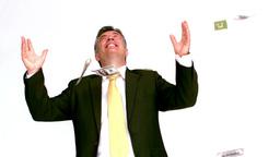 Happy businessman enjoying falling bills Footage