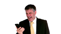 Businessman screaming on mobile phone Stock Video Footage