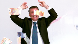 Businessman launching euro bills Stock Video Footage