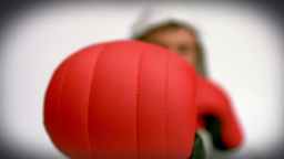Focus shot on the man punching with red gloves Footage