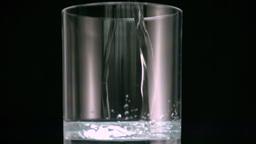 Water filling glass Stock Video Footage