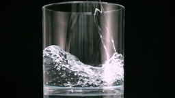 Water filling glass Footage