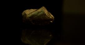 Large golden nugget falling Footage