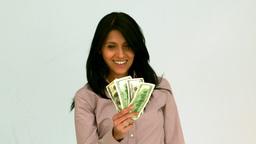 Happy woman fanning bills Footage