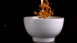 Bowl being filled by milk and cereals Footage