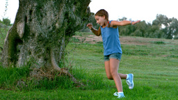 Young child running around a big tree Stock Video Footage
