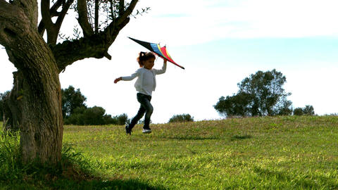 Little girl running with kite Footage