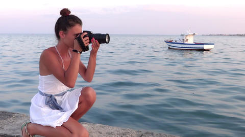 nice girl taking a photograph with her camera Stock Video Footage