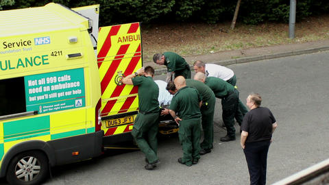 Rescue operation. Paramedics pushing the patient o Footage