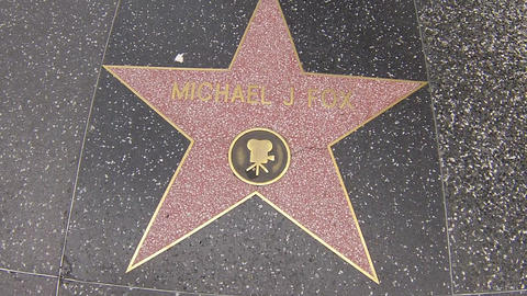 hollywood walk of fame star walking shot michael j Stock Video Footage