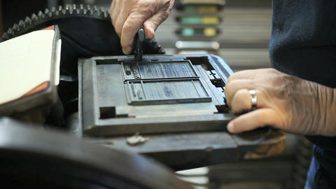 printer tightens type in a chase Stock Video Footage