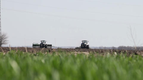Gray Tractor Go On Black Earth Field stock footage