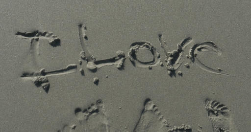 2011 Love Written in the Sand at the Beach, 4K Stock Video Footage