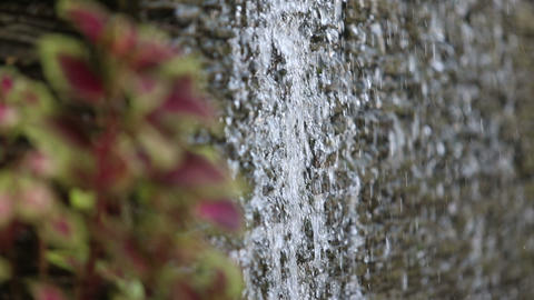 water flows through stone wall Footage