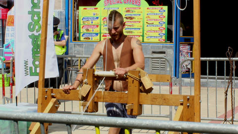 Spring pole lathe - carpenter demonstrates how to  Footage