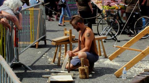 Medieval method of wood chopping demonstration Footage