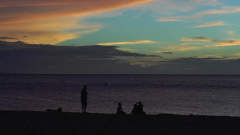 silhouettes of people on the beach during sunset Footage