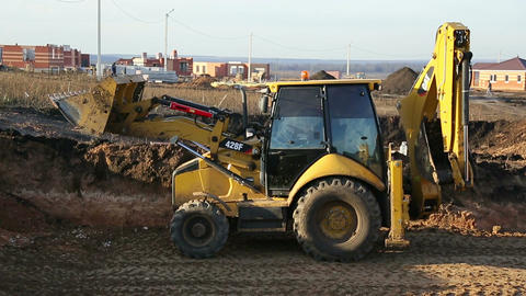 Excavator compacts the ground Stock Video Footage