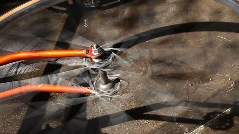 spinning bike wheel Stock Video Footage