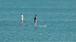 Women Stand Up Paddle Boarding in the Ocean Footage