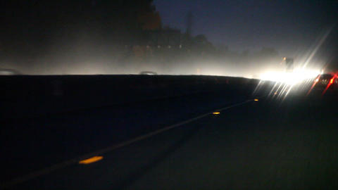 heavy rain on freeway with headlights Footage