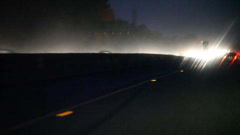 heavy rain on freeway with headlights Footage