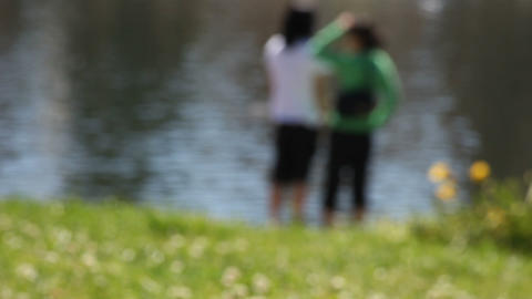 People By A Lake On A Sunny Afternoon stock footage