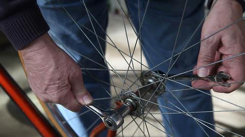 putting bike wheel back on Footage