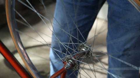 putting bike wheel back on Stock Video Footage