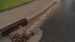 rainwater pouing into gutter Stock Video Footage