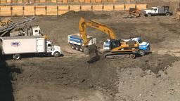 HD2008-7-9-11 const site backhow dumptruck Stock Video Footage