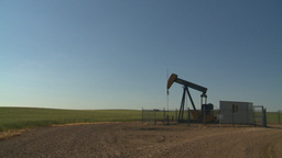HD2008-7-14-30 evening pumpjack Stock Video Footage