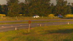 HD2008-7-14-61 Police cars i[on highway fast Stock Video Footage