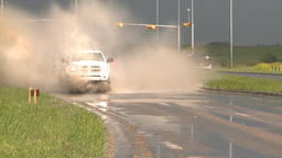 HD2008-7-15-8 rain flooded road truck and cars splash Stock Video Footage