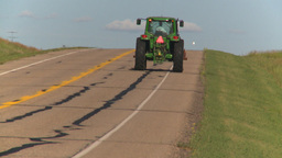 HD2008-7-16-56 farm tractor highway Stock Video Footage