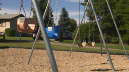 HD2008-7-17-16 empty kids playground swingset Stock Video Footage