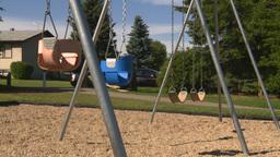 HD2008-7-17-16 empty kids playground swingset Stock Video Footage
