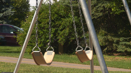 HD2008-7-17-18 empty kids playground swingset Stock Video Footage
