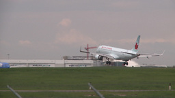 HD2008-6-1-31 AC airbus idle jet lands thru frame Stock Video Footage