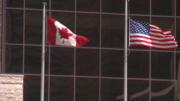 HD2008-6-1-35 Cdn and US flags Footage
