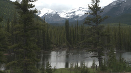 HD2008-6-3-28 pond and mountains Stock Video Footage