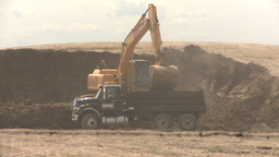 HD2008-6-5-13 backhoe and dumptruck Stock Video Footage