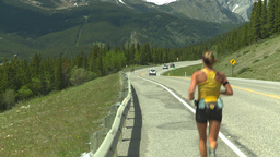 HD2008-6-5-47 jogger on highway Footage