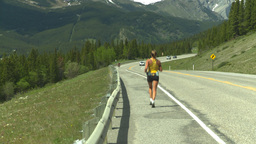 HD2008-6-5-47 jogger on highway Stock Video Footage