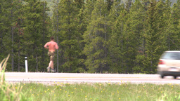 HD2008-6-5-55 jogger on highway Footage