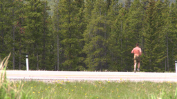 HD2008-6-5-55 jogger on highway Stock Video Footage