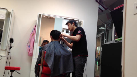 Men having an haircut in a hairdressing salon Stock Video Footage