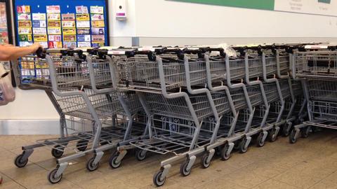 Customer returning shopping cart Stock Video Footage
